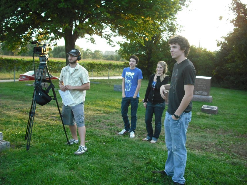 Paranormal enthusiasts from Rockford College watch the filming.