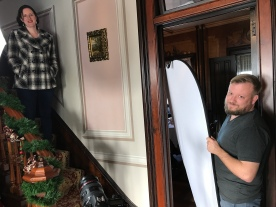 Host Amelia Cotter prepares for a scene while Director of Photography Greg Inda makes sure the lighting is perfect at Tinker Swiss Cottage in Rockford, IL.
