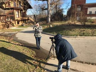 Host Amelia Cotter brushes up on her lines between takes outside Tinker Swiss Cottage in Rockford, IL.