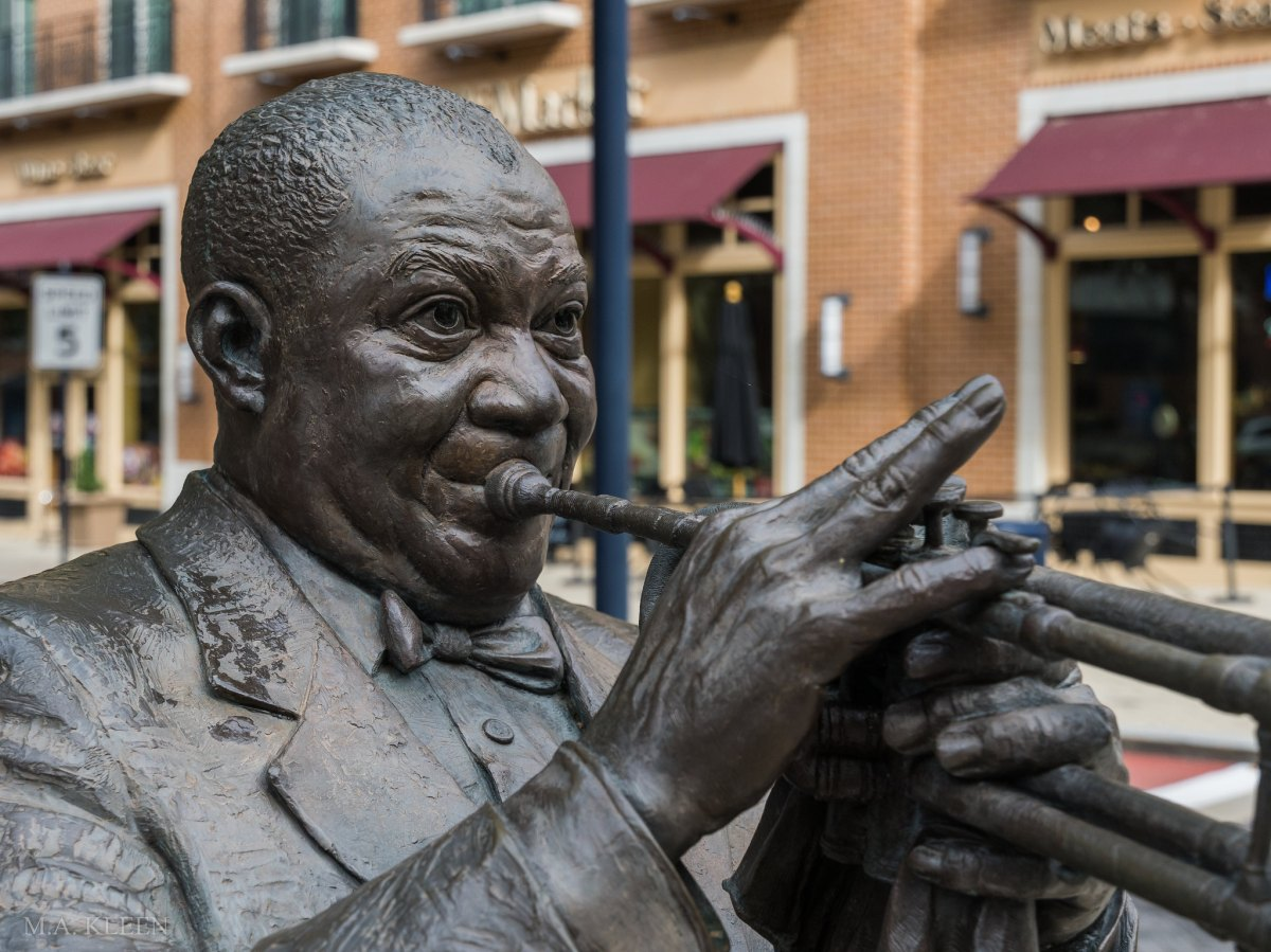 Statue of Louis Armstrong by artist Ivan Schwartz on American Way in National Harbor, Maryland.