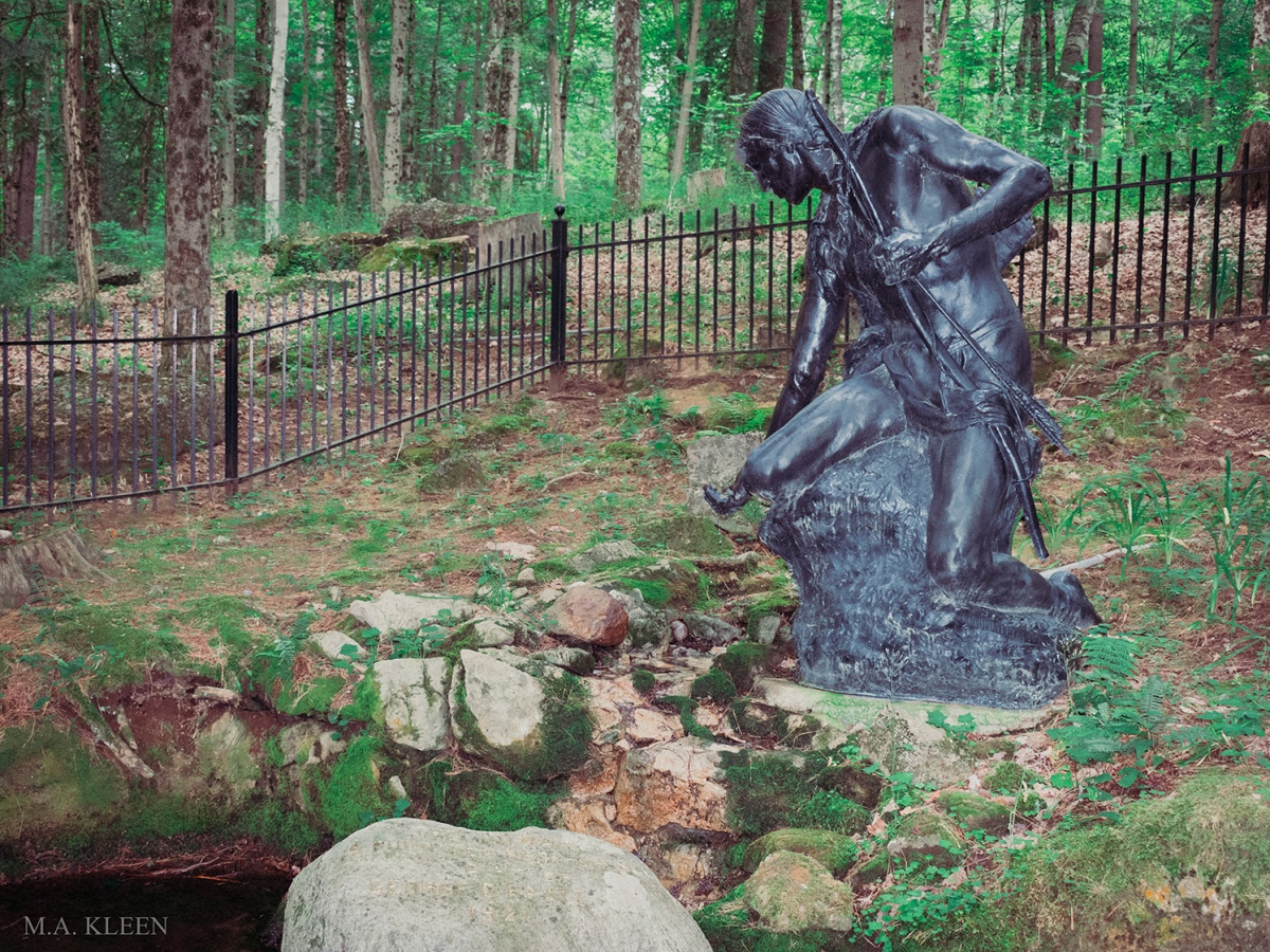 This bronze statue of a Mohawk brave reaching to take a drink of water from a spring sits in Lake George Battlefield Park in Warren County, New York.