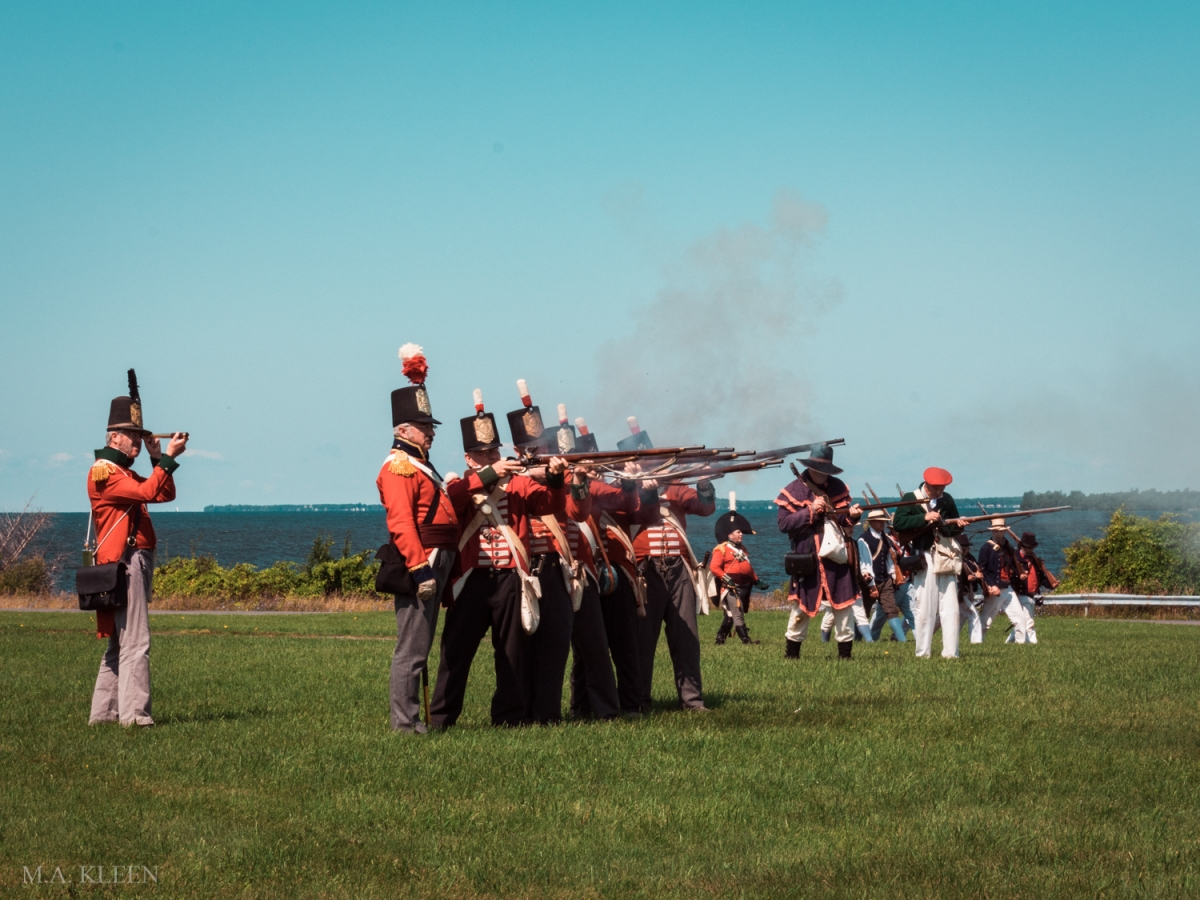 Reenactors dressed as British soldiers fire a volley during an event commemorating the Second Battle of Sacket's Harbor, fought on May 29, 1813.