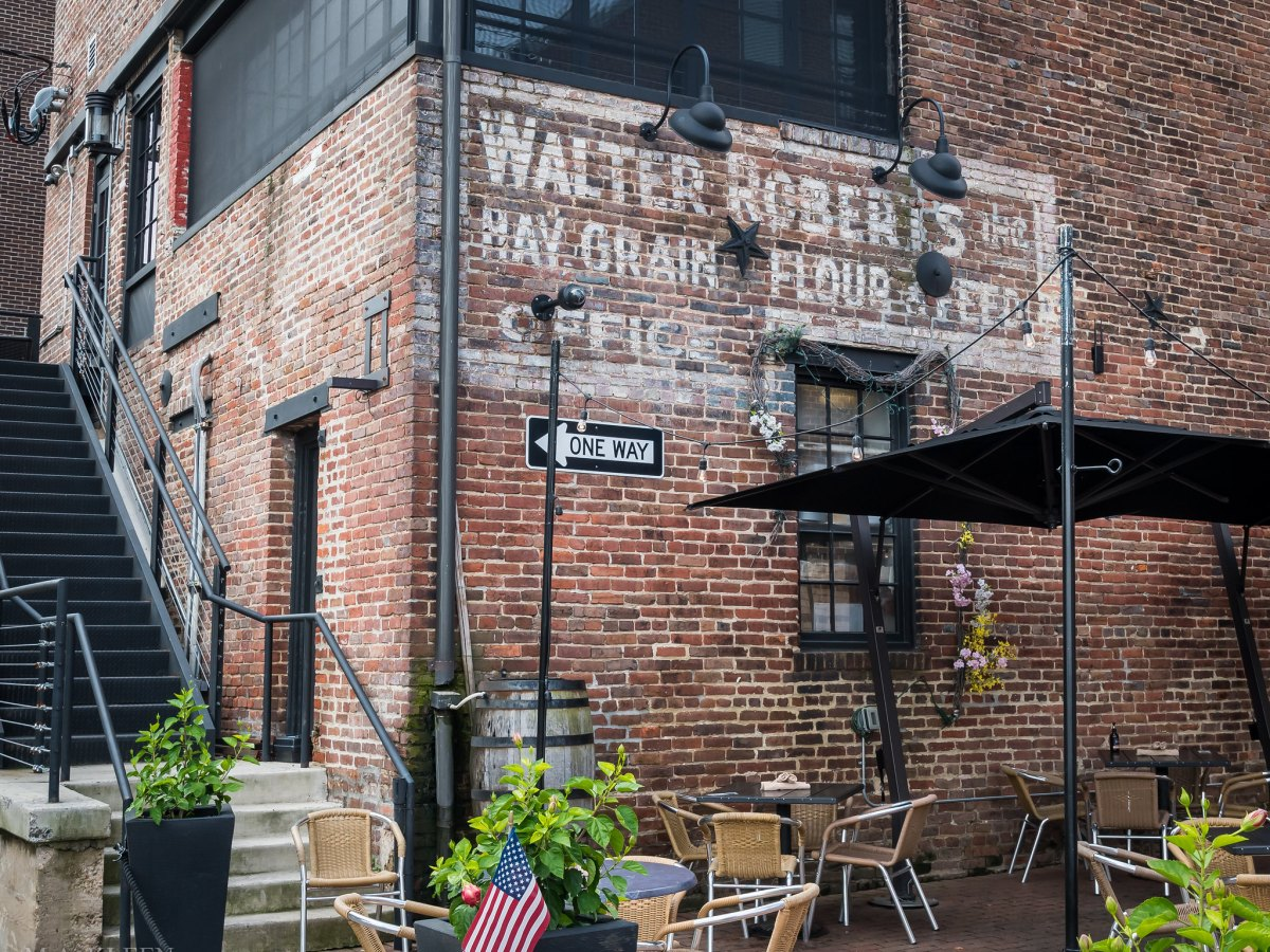 Old brick ad for Walter Roberts Inc Hay Grain, Flour, and Feed Office in Alexandria, Virginia. Today on the side of Virtue Feed & Grain restaurant, 106 S. Union Street.