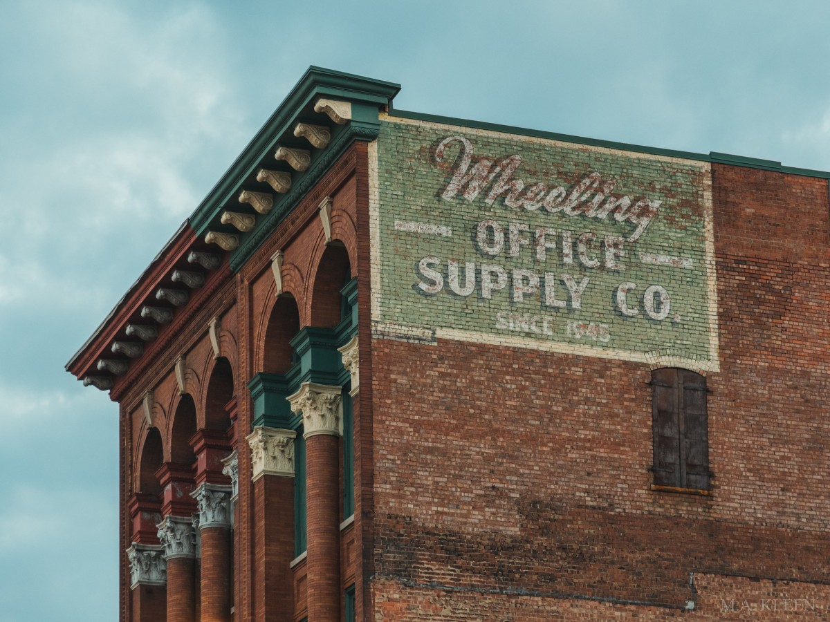 Brick ad for Wheeling Office Supply Co, 1420 Market St, Wheeling, West Virginia.